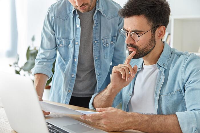 two-successful-stylish-man-financiers-analyze-business-documents-work-new-startup-project (1)